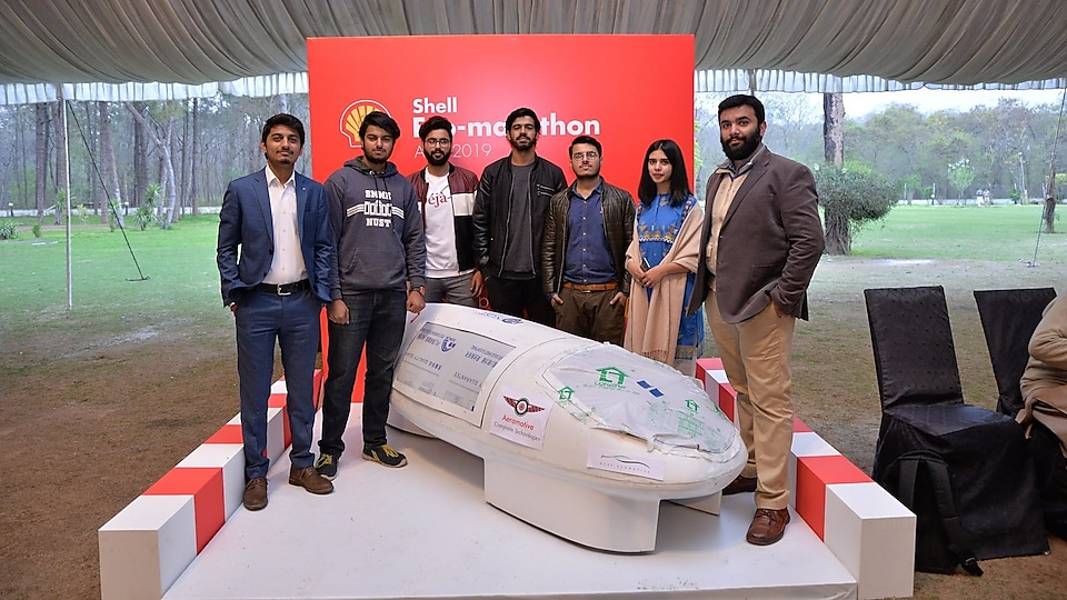 seven students with their prototype