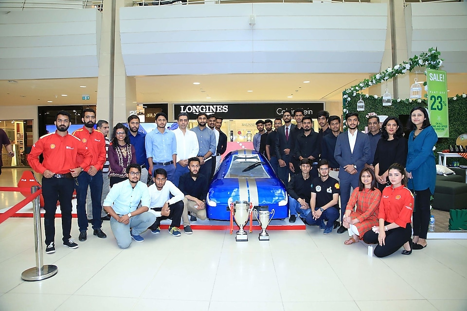 Shell Eco-marathon students with their prototype car