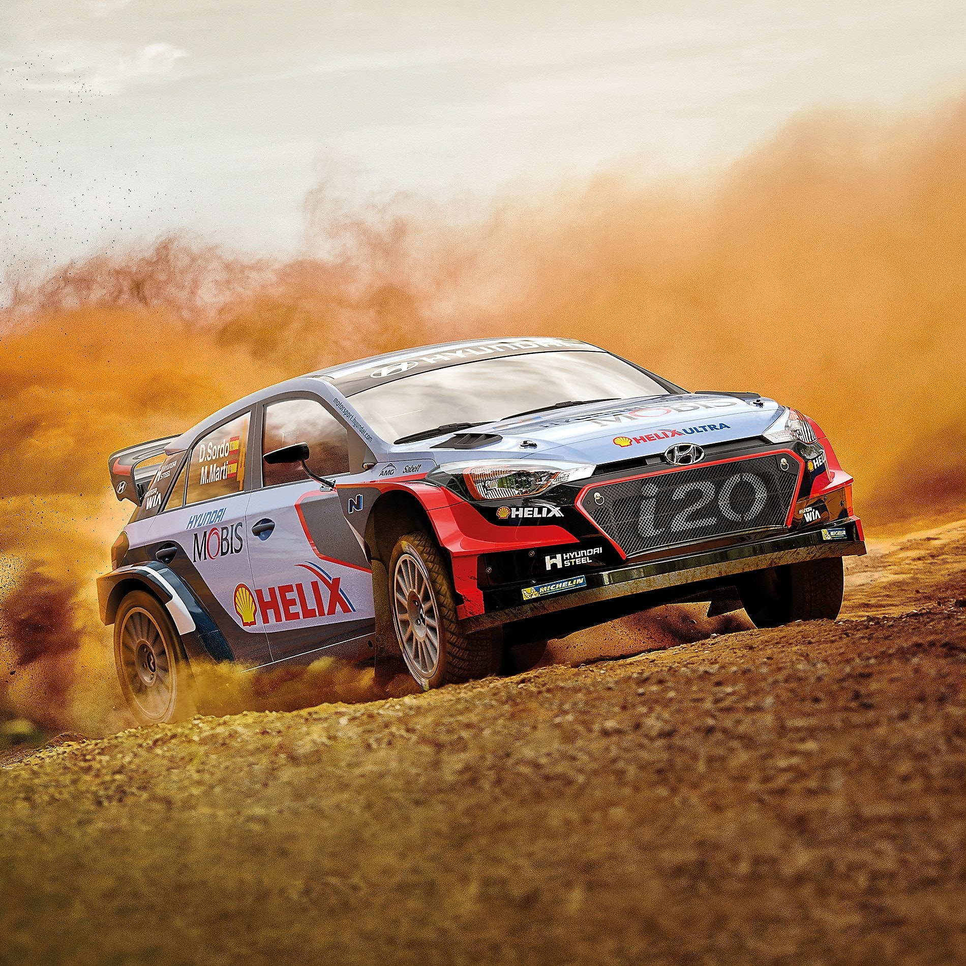 A Hyundai Motorsport car kicks up a cloud of dust on a dirt race track, exemplifying the great performance of using Shell Helix Ultra in extreme environments